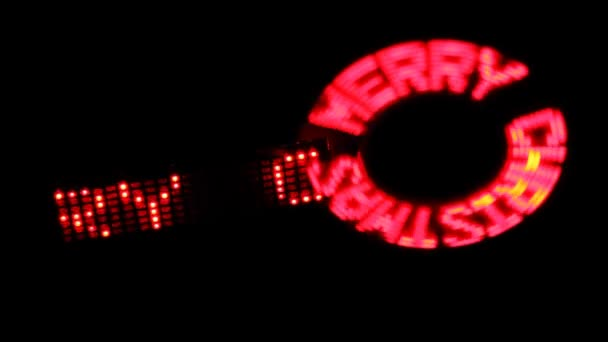 Rotating glowing inscription in circle and running line MERRY CHRISTMAS on black