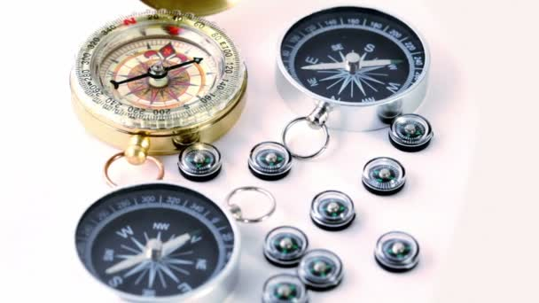 Nine small black plastic compasses, two big and one vintage golden