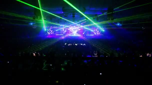 Lot of people at rave party in large congested hall
