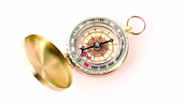 Golden vintage compass rotates
