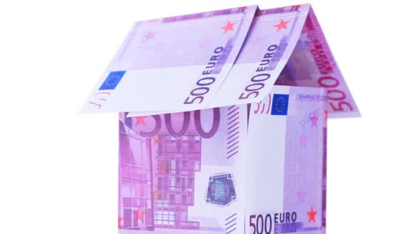 House made from euro bills spinning, they with inscription souvenir