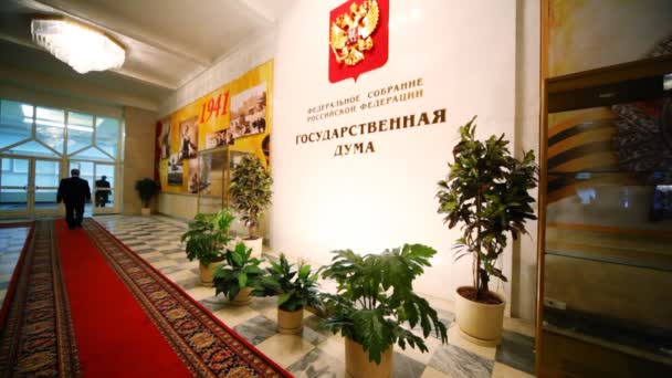 Officials passing by in hall of Russian parliament