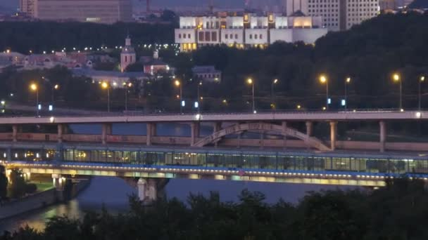 Luzhnetsky bridge through river is shone by lanterns