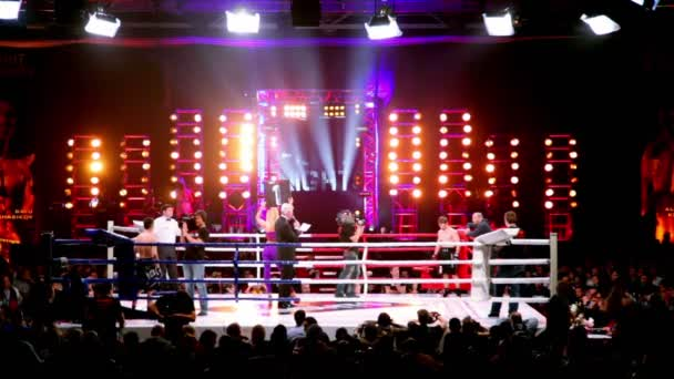 Two athlete on boxing ring, woman walk and show 1st round plate at The Battle of Moscow 3