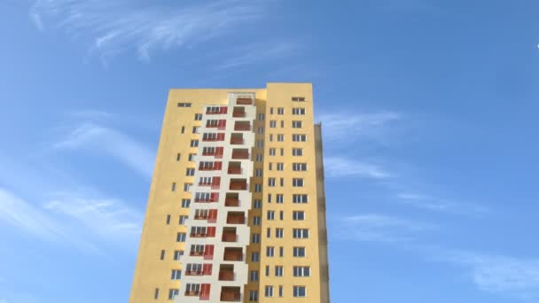 Blue sky roof high-rise building of yellow color