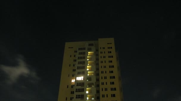 Light shine in windows of high-rise building at night