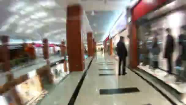 Buyers walk and visit shops of shopping center