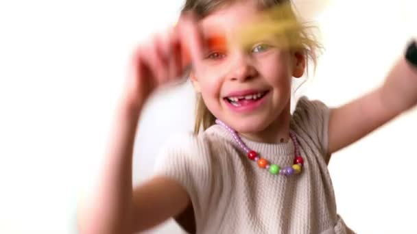 Little girl with slingshot isolated