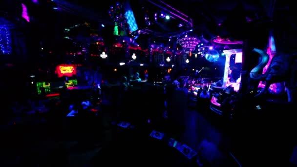 Many people in dark night club