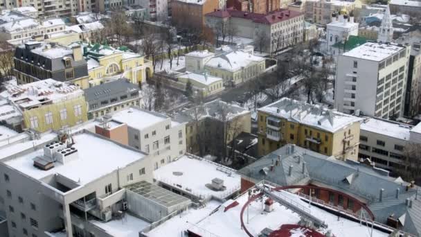 Roofs of houses are covered with white snow, time lapse