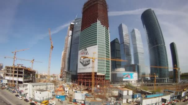 Cars go near building Moscow City business center in afternoon