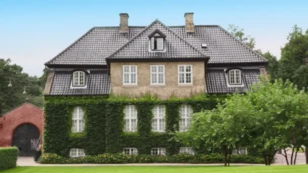 Medieval edifice with ivy on walls among trees in Copenhagen
