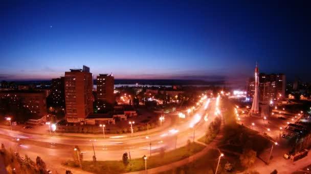 Cars go on street of night Samara near Monument Rocket