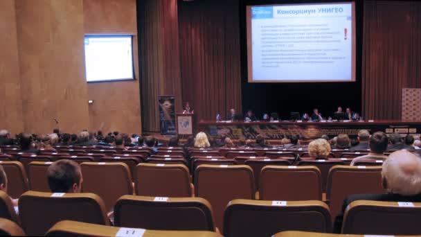 Woman scientist represents scientific report at Conference