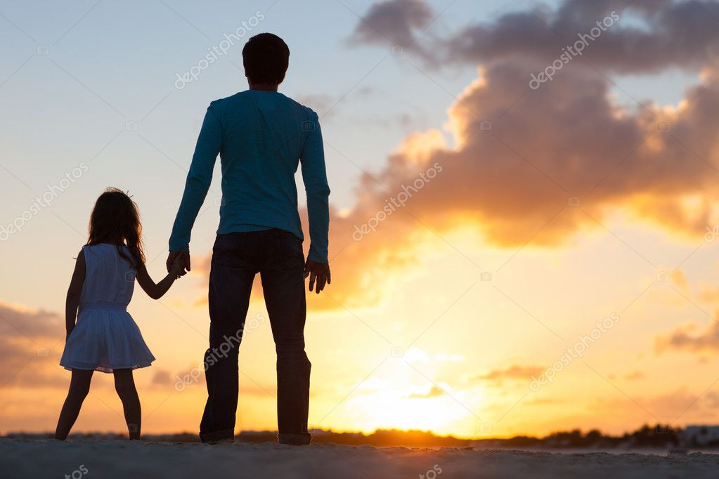 Father and little daughter silhouettes on beach at sunset stock vector