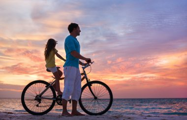 Father and daughter on a bike
