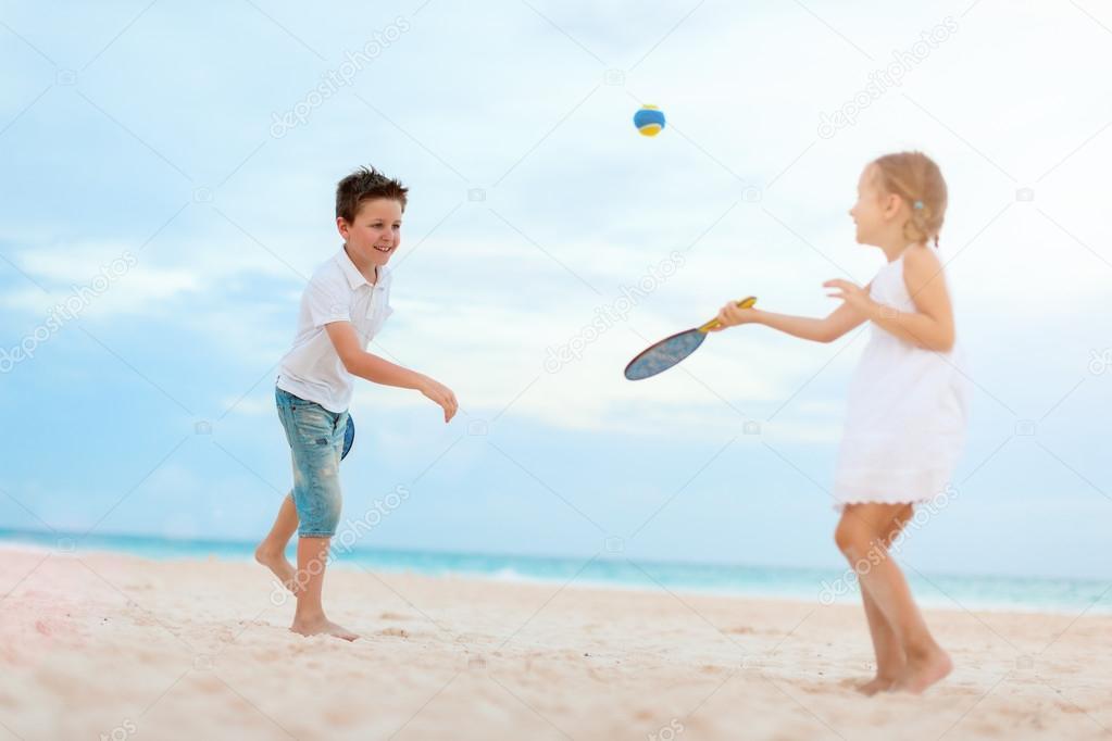 Kids playing beach tennis