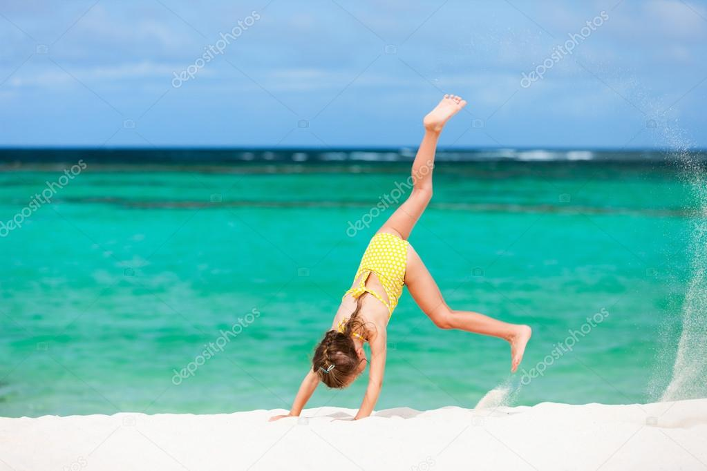 Cute little girl having fun on beach vacation