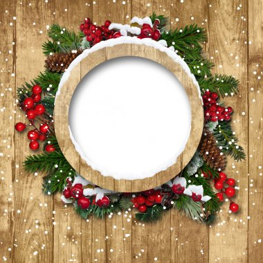 Christmas frame with decorations on a wooden background
