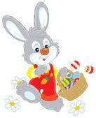 Fotografie Easter Bunny with a basket of eggs