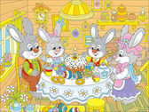 Fotografie Easter bunnies at the festive table