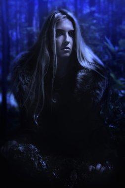Scandinavian girl in the night forest