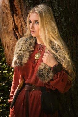 Scandinavian girl with runic signs