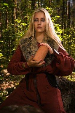 Scandinavian witch pythoness with runes