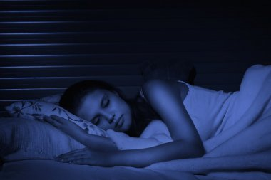 Sensual girl sleeping in the bedroom
