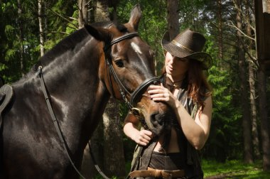 Cowgirl and brown horse
