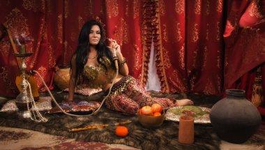 Beautiful arabic woman with hookah
