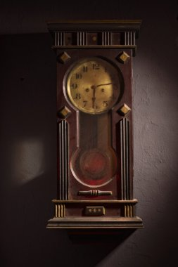 Grandfather clock hanging on a wall