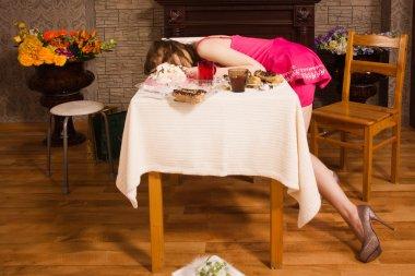 Crime scene simulation. Poisoned girl lying on the table