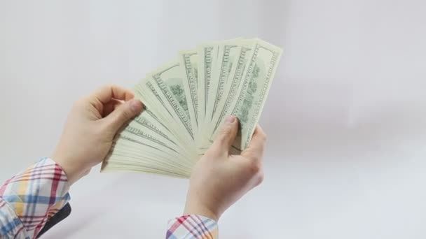 Man paying with american dollars on white background