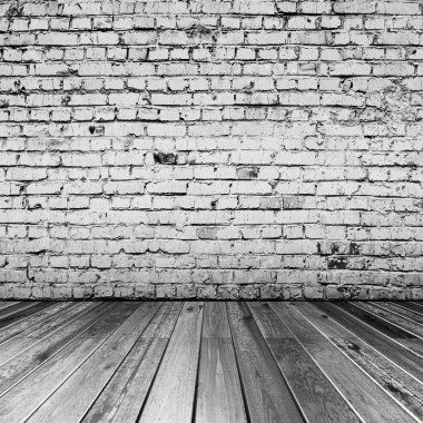 Bricks in black and white room