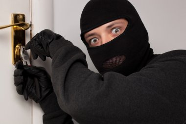 Thief Burglar opening door
