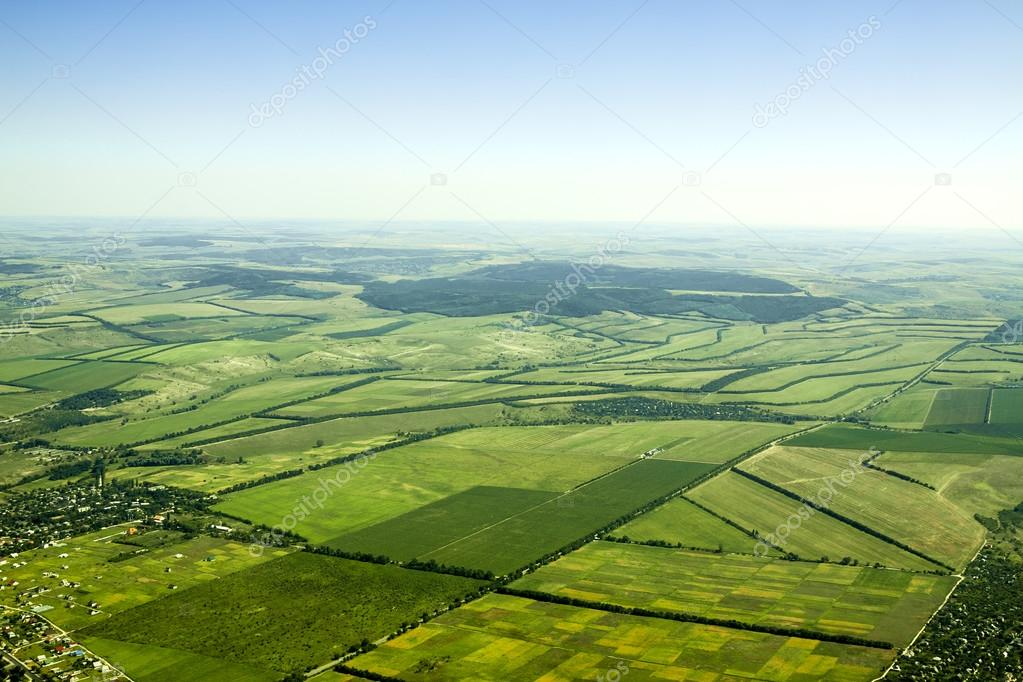 Aerial view of a green rural area under blue sky