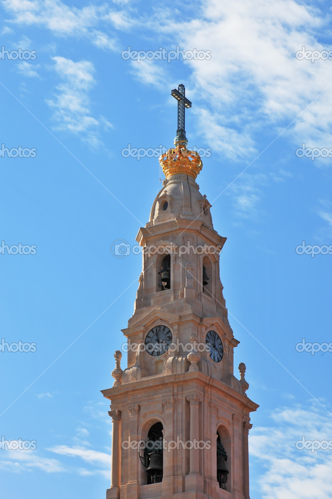 The picturesque tower, topped by a cross