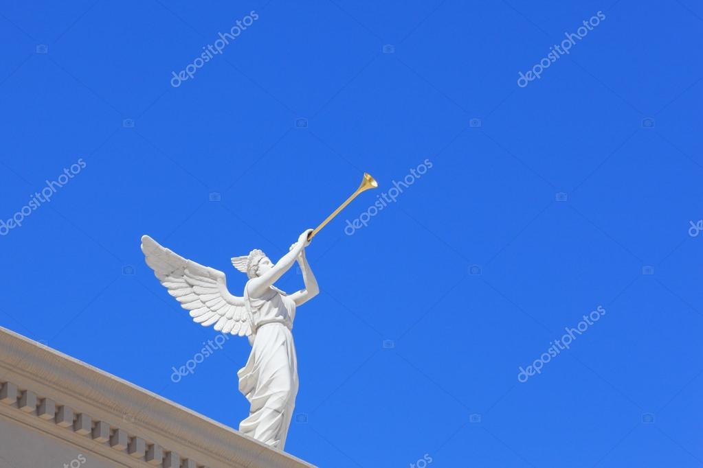 A white statue of a winged troubadour