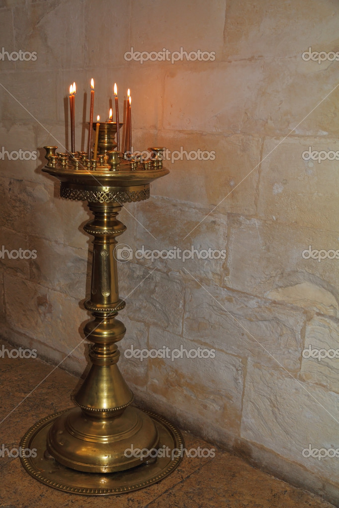 Bronze Floor candlestick with burning candles