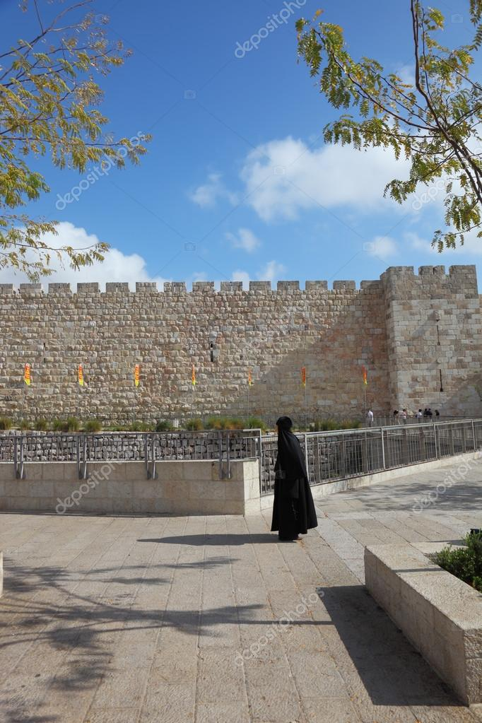 Pilgrim at the walls of the City of David
