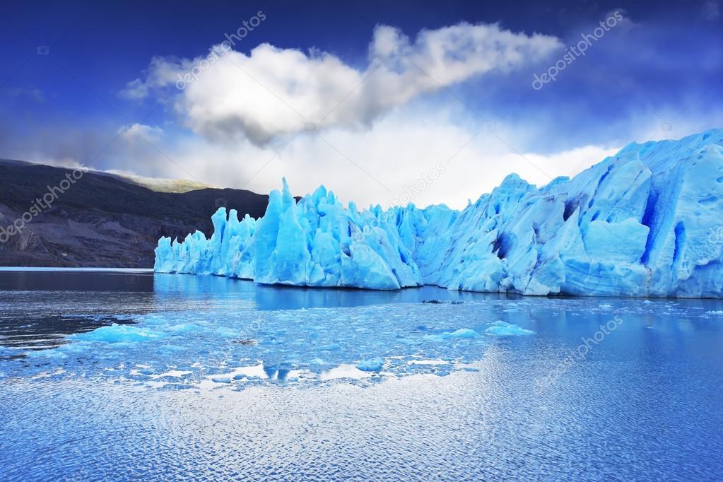 Grey glacier moves down the water