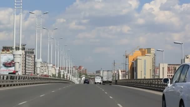Driving on the bridge named after the sixtieth anniversary of victory. Omsk. Russia.