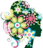Fényképek Gyönyörű nő sziluettje egy virágokkal