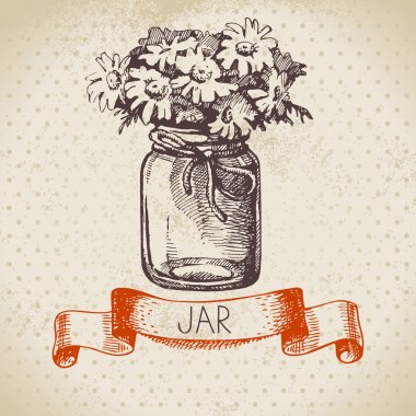Rustic jar with chamomile bouquet.