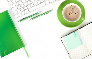 Green coffee cup and office supplies