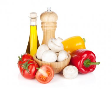 Fresh vegetables and mushrooms with olive oil and pepper shaker