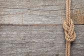 Fotografie lodní lana uzel na dřevěné textury pozadí