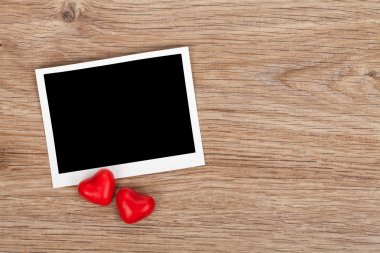Blank instant photo and red candy hearts
