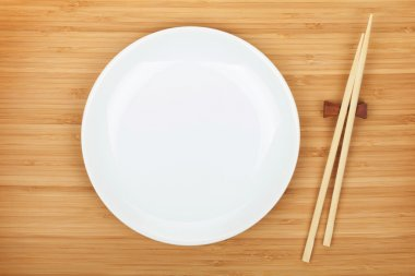 Empty plate and sushi chopsticks